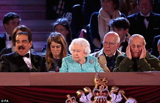 Front-row seat: King Hamad bin Isa Al Khalifa of Bahrain, left, was seated in the Royal Box between the Queen and the Duchess of Cornwall for Her Majesty's 90th birthday celebrations at Windsor Castle last night