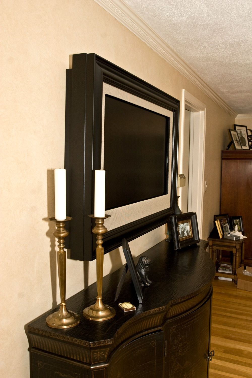 frame a wall mounted tv love the way this looks but it 39 s. Black Bedroom Furniture Sets. Home Design Ideas
