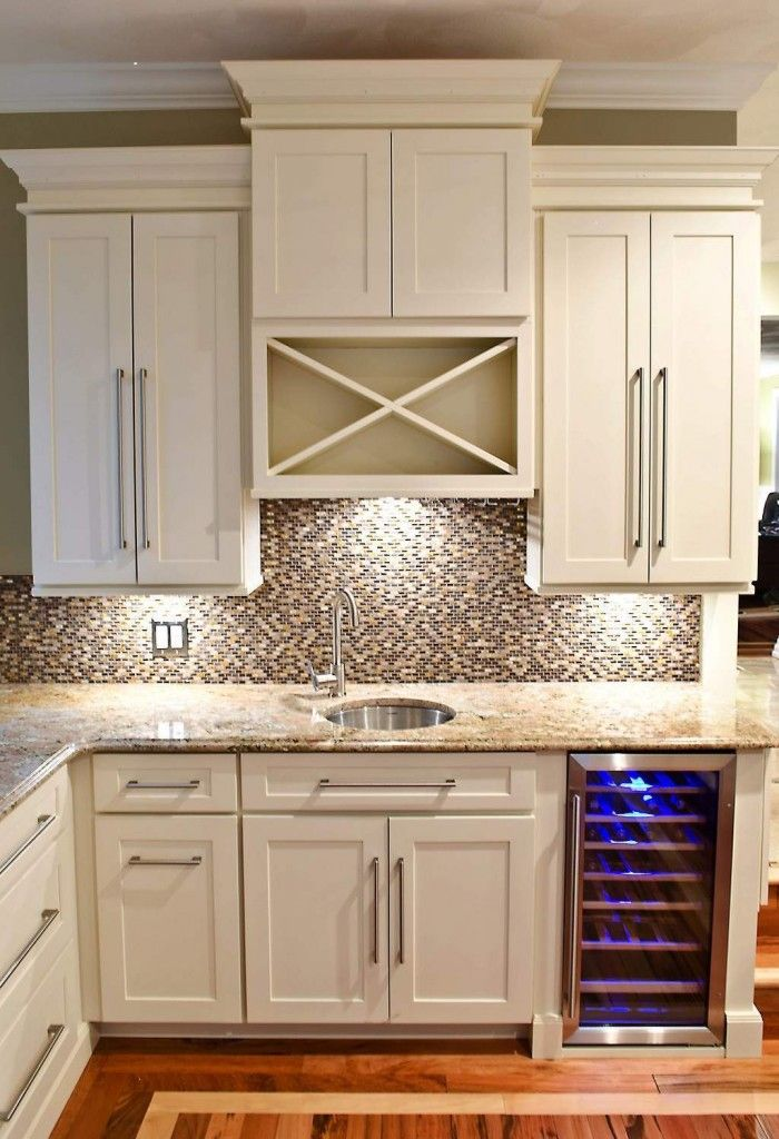 wet bar built of white shaker cabinets with builtin wine cooler in base and - Built In Wine Fridge