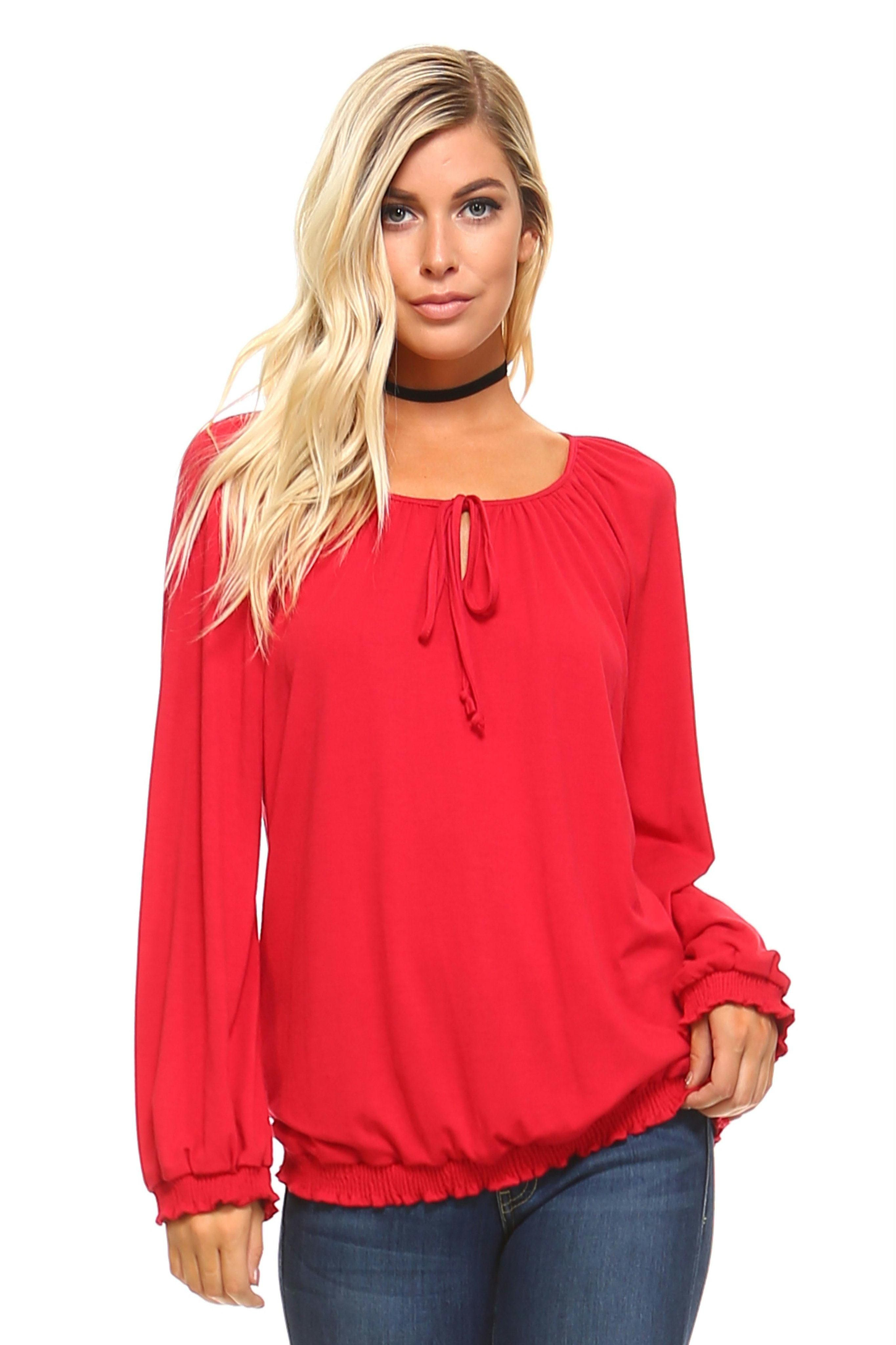 c48b0a69d16 Women's long sleeve, loose fit peasant top with decorative tie on top and  elastic band at the bottom. Model is wearing a size Small 64% Polyester 33%  Rayon ...