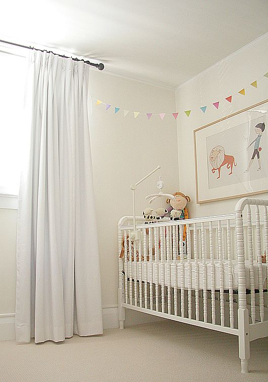Place Crib Angled In Corner With Bunting Draped Above