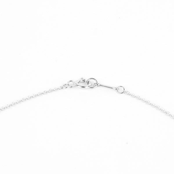 6704f164d Pre-Owned Tiffany & Co Paloma Picasso Heart Pendant crafted in 18K white  gold and graced with nine, round brilliant diamonds weighing 0.10 carats.