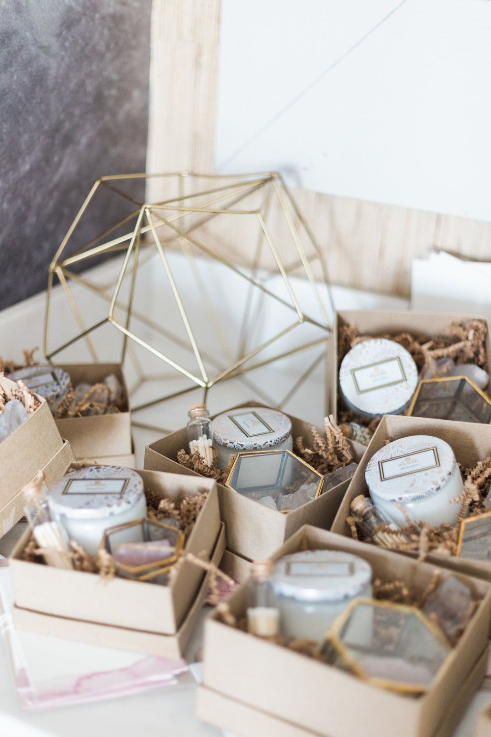 Party favors included Voluspa candles, mini match bottles, brass ...