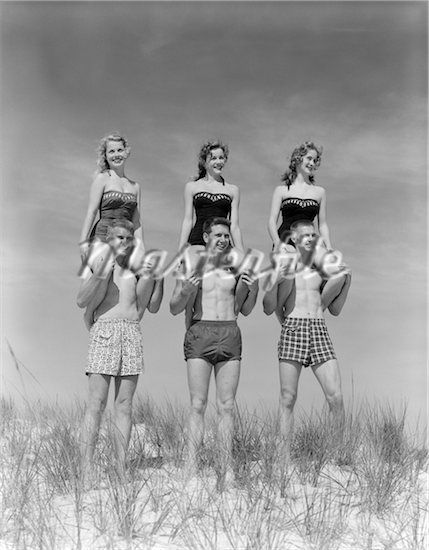 fd2e631a57 1950s - 1960s THREE COUPLES AT BEACH ON DUNES WITH WOMEN IN IDENTICAL BATHING  SUITS SITTING ON MEN S SHOULDERS - Stock Photos   Masterfile