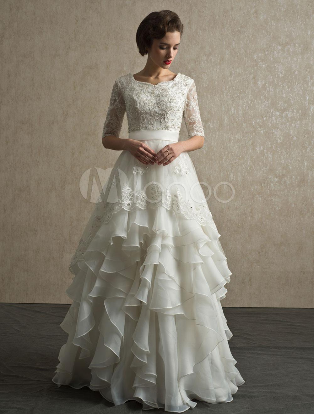 Vestido de noiva marfim linhaa em organza e camadas com manga e