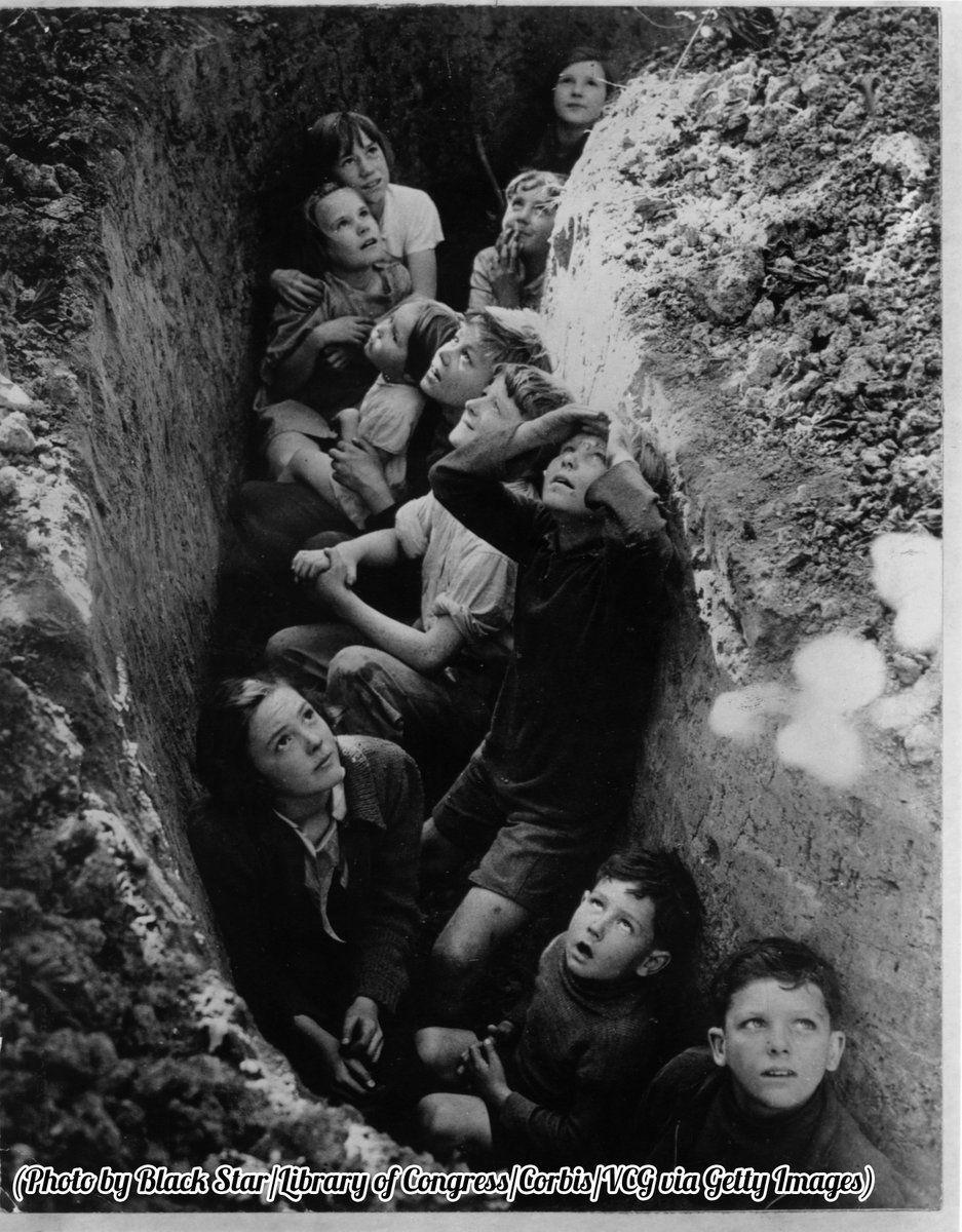 @HistoryInPix : English children huddle in a trench during a German air raid 1940. https://t.co/gnh0oJ2P88