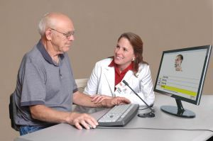 Aphasia, stroke, speech & language therapy. Therapist demonstrating therapy software for speech & language.