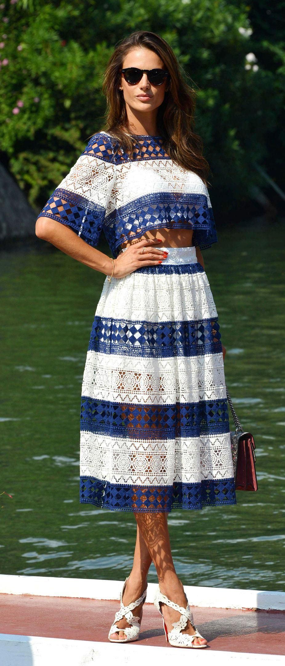 Alessandra Ambrosio did casual blue and white stripes when arriving in Venice - click for more film festival outfits we love