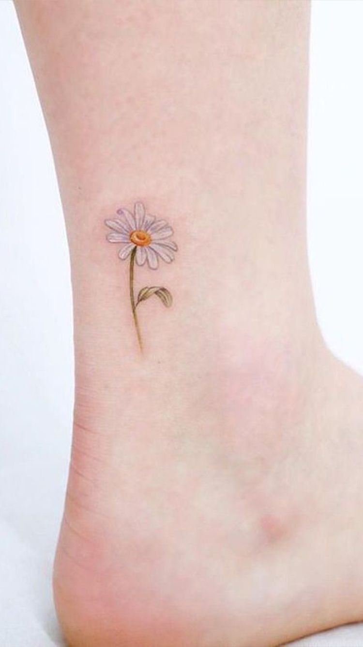 The Meaning Of Your Favorite Flower Tattoos Daisy Flower Tattoos Ankle Tattoo Delicate Flower Tattoo
