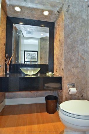 modern powder room with pegasus etched spiral vessel