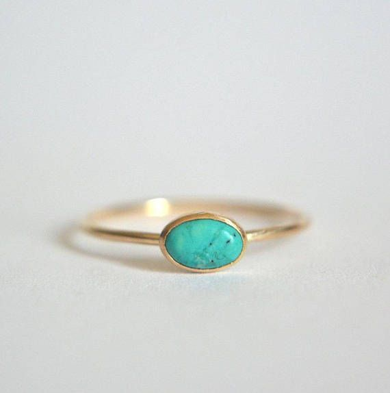 Beautiful natural turquoise in solid 14k gold. Small 6x4mm natural turquoise stone. These vary from stone to stone in color and detail. The stone is hand set in a solid 14k gold bezel. The band is 14k solid gold and thin at 1mm. Polished for a beautiful shine finish. *We have other natural gemstones that are available to customize your ring, at no additional cost: opal, ruby, rainbow moonstone, aquamarine, garnet, amethyst, black spinel or lapis lazuli. Please leave me a note in the note to…