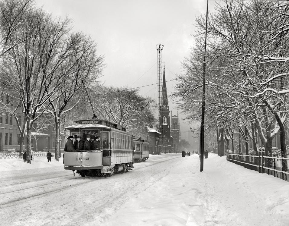 Woodward Avenue in winter attire, circa 1910. With one of the city's arc-lamp moonlight towers