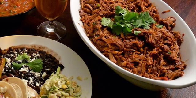 "Brewforia's Beer Market's Pulled Pork.. a ""fantastic dish that requires almost no effort beyond tuning on the crock pot,"" says Brewforia Beer Market owner Rick Boyd who loves the simplicity of this recipe. ""Big bold Latin flavors and a final product that is great for tacos, sandwiches, salads or chilled by itself."""