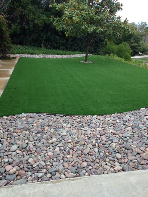 river rock and artificial turf