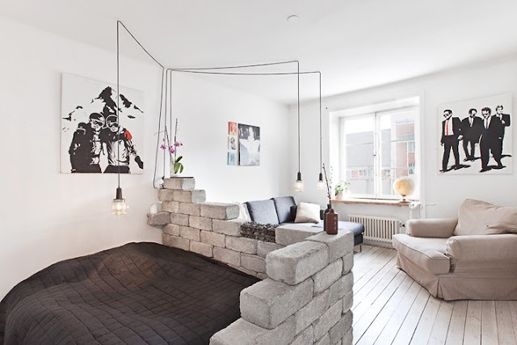 Fake brick wall smack dab in the middle of the living room of a home in Sweden.     Photo from Sight.