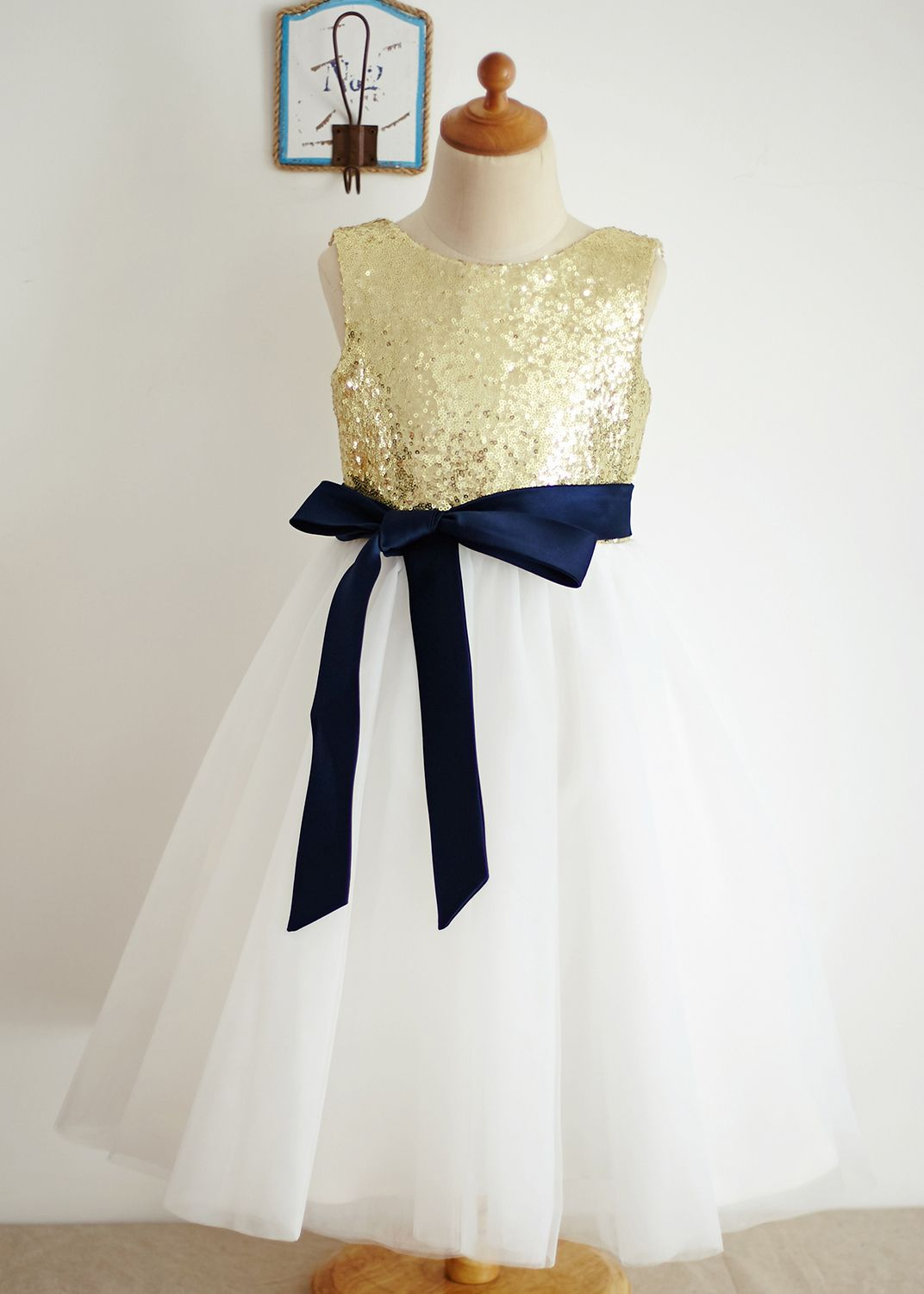 a57c3b273 Just love the deep v back design.We use satin,sequin and tulle to make this  dress.The listed color is gold top,ivory bottom with navy blue sash.