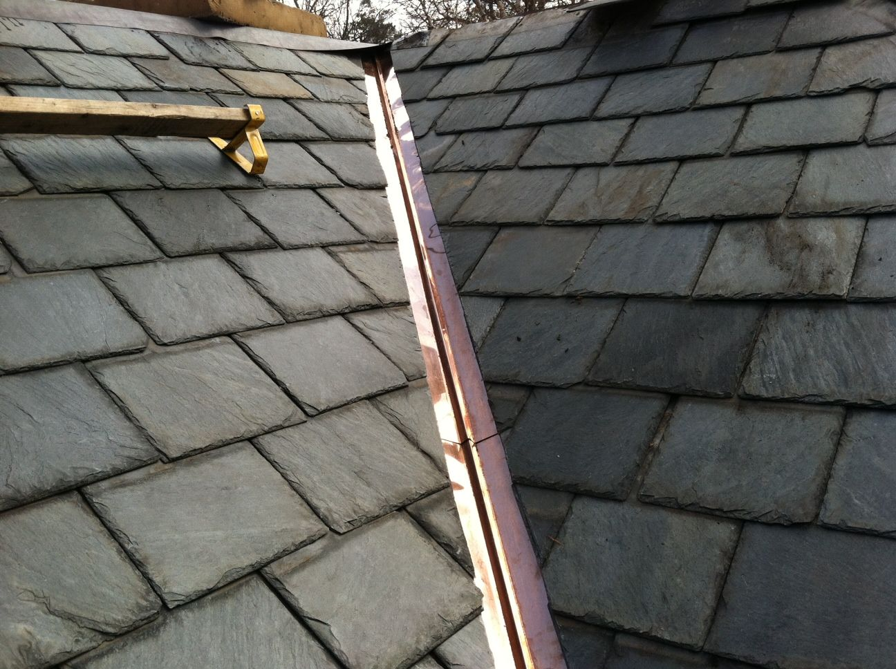 Copper Valley Replacement On Buckingham Slate Roof Www Charlotteroofing Com Slate Roof Roofing Specialists Door Handles