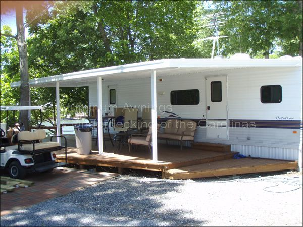 Aluminum awning attached to rv lodge deck screen room for Rv decks