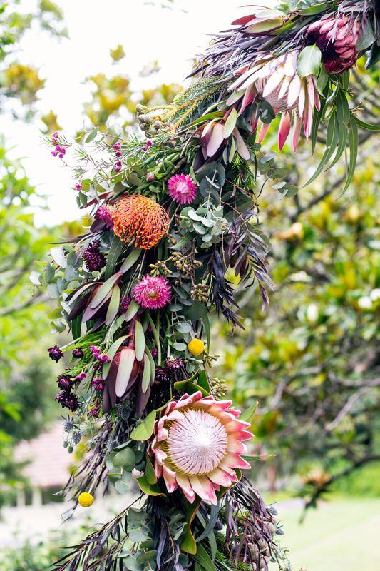 Samuel and Brianna - Ceremony Arch native flowers protea