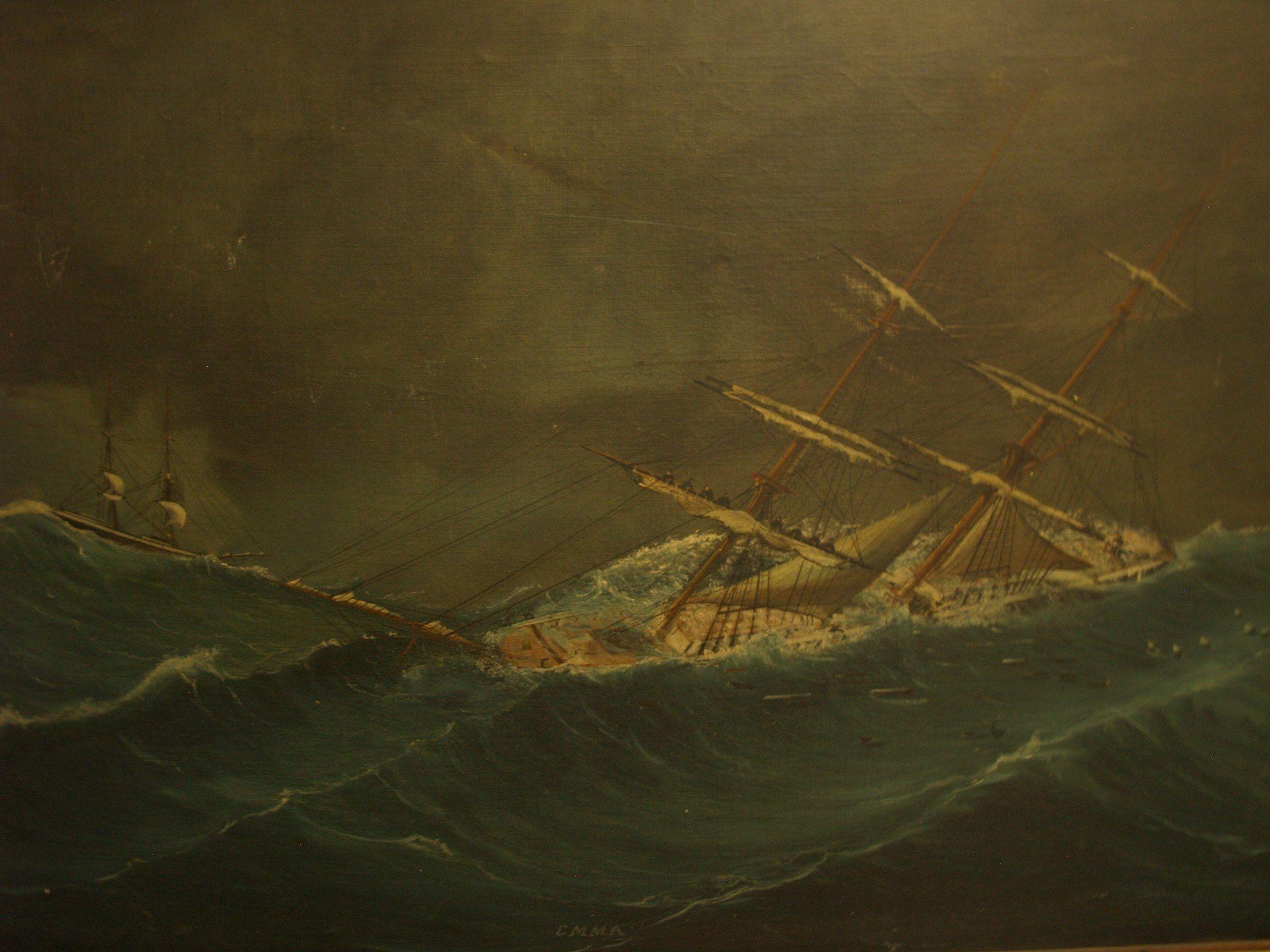 Briggen Emma ute i hardt vær. Endel av mannskapet sees arbeide i riggen med å berge seilene.