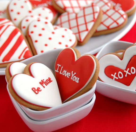 red and white hearts with different patterns on them. and words, X O