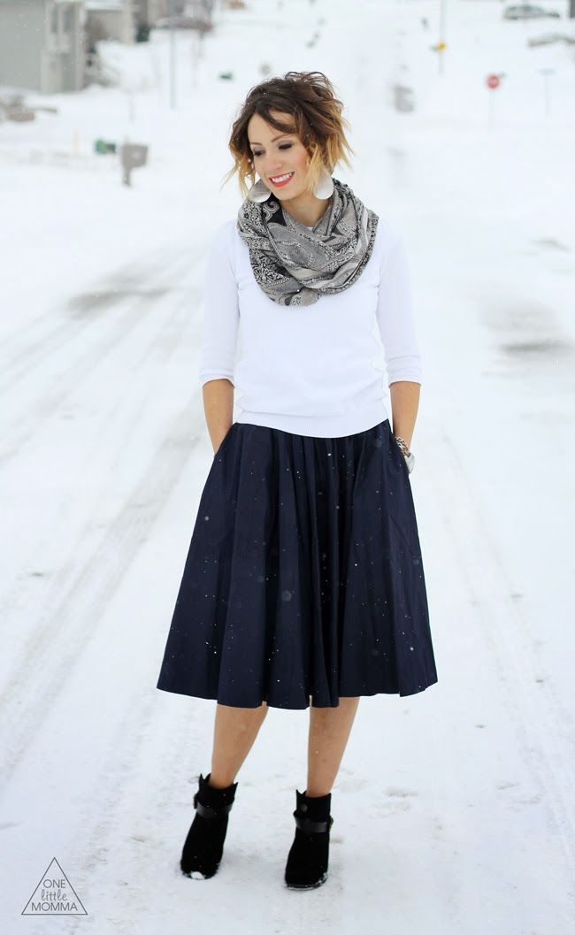 Full navy midi skirt paired with black ankle boots and sweater ...
