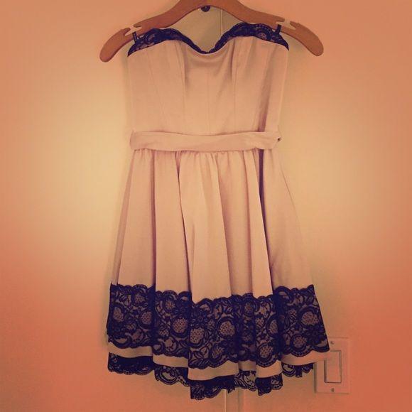 Bebe strapless full skirt fit & flare dress Bebe strapless fit & flare dress. Full skirt, corset-style top. Removable halter strap.. bebe Dresses Strapless