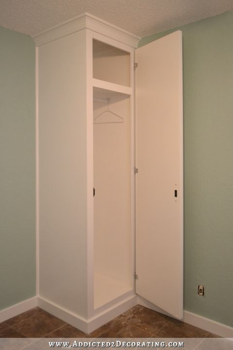 Diy how to build cabinet style closets to flank your bed for Diy clothes closet