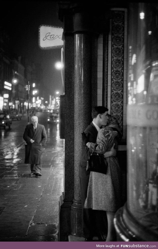 A rainy night in Oxford Street, London, 1960. Photograph by Philip Jones Griffiths.
