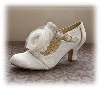 This was my first choice! Dorothy Shoes, found at link given below. £75.00  but even these are almost three inch heels....sigh.