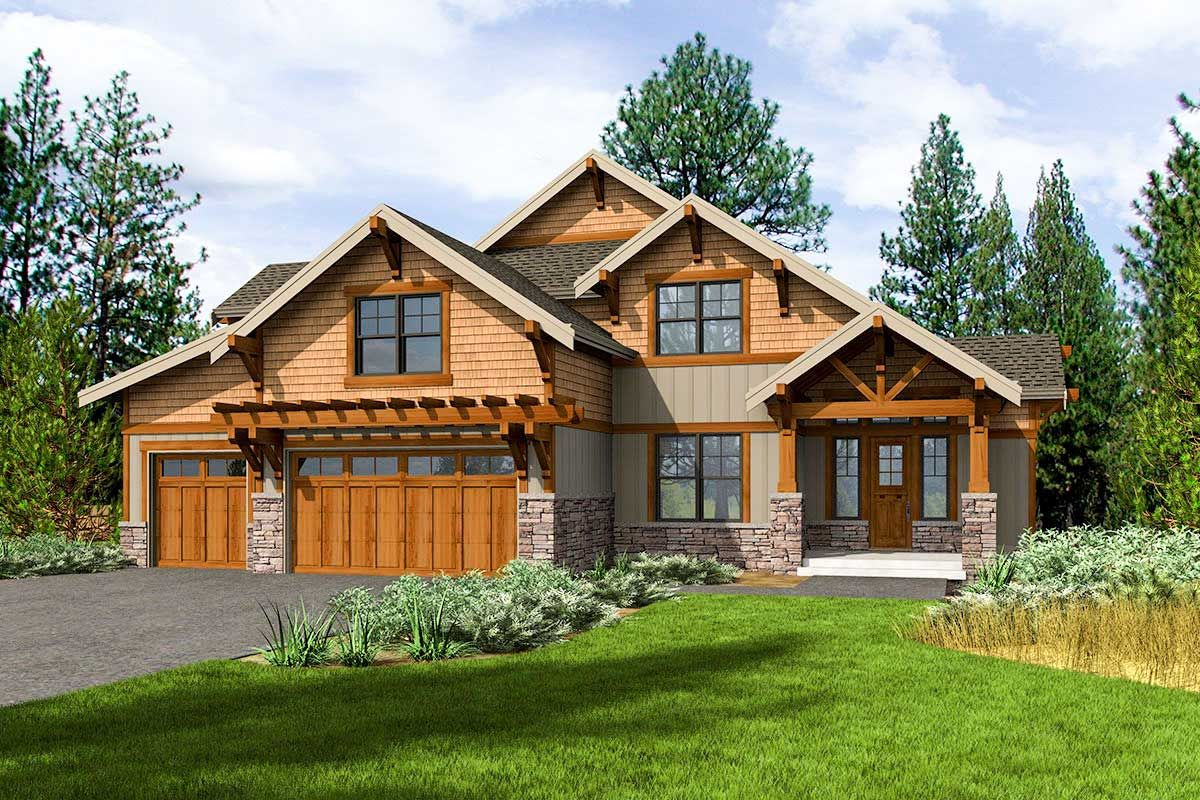 Rustic gabled roofs shake siding and board and batten siding all contribute to the exquisite exterior of this 4 bedroom mountain craftsman house plan