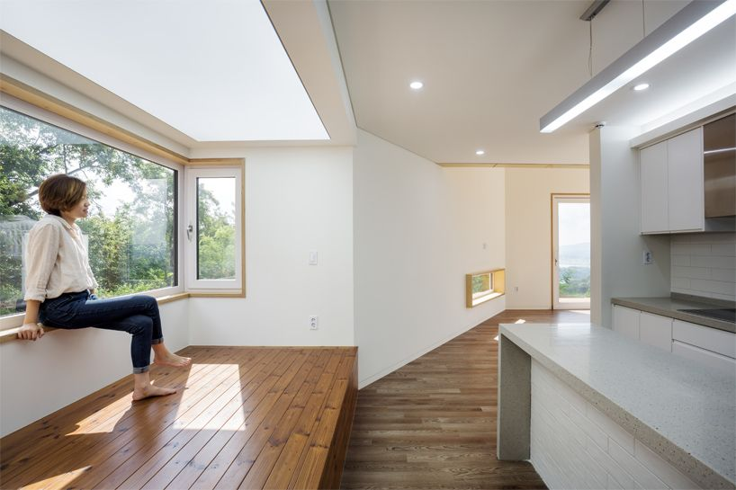 B.U.S architecture builds house around a found rock in seoul