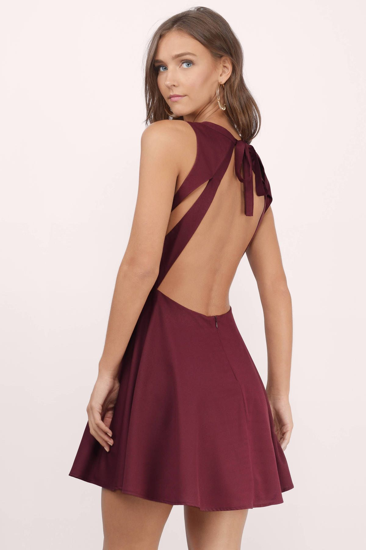 dc10df25e9 You ll fall in love with the Andie Open Back Skater Dress. Featuring a  plunging neckline and open back. Pair with stilettos and a clutch.
