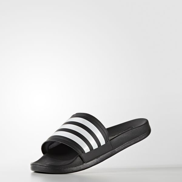 After swimming you ll want to slip into the simple comfort of these women s  slides. It s the classic adilette sandal with iconic 3-stripes style. e82c87c0a