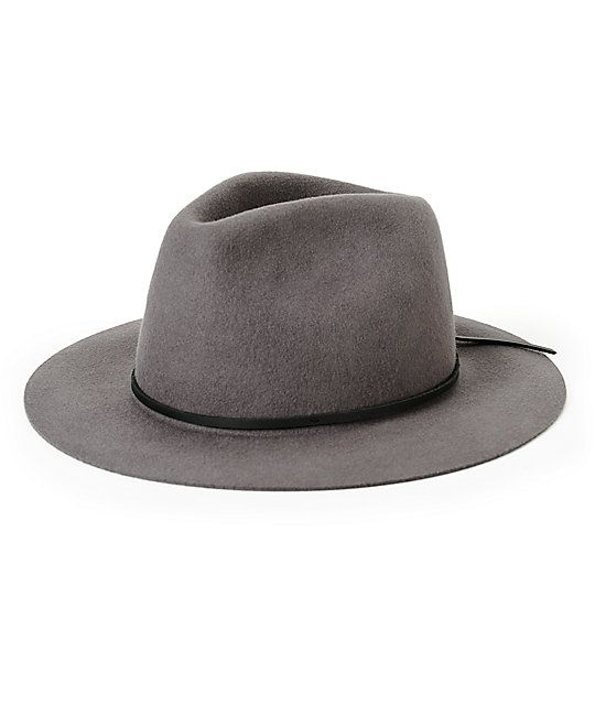 3fbfd705698 A wool fedora with a wide unfinished brim and black leather band  surrounding the crown.