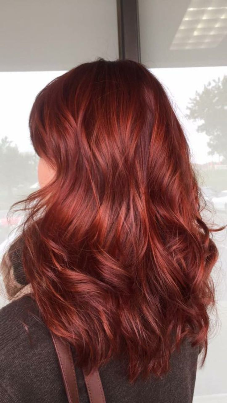 This cool toned red hair is perfect for winter and the holidays