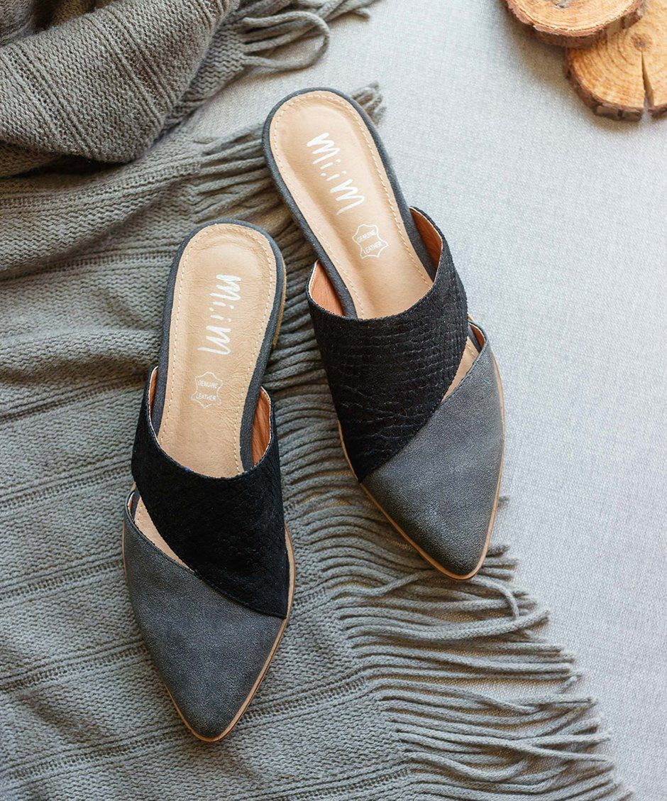 The Epic   TwoToned Pointed Business Mule is part of Women shoes, Girls shoes, Casual shoes women, Shoes, Cute womens shoes, Womens fashion shoes -  Not sure what to wear to that business meeting   Now you are  Meet The Epic your casual but businesssensible statement mule  It's designed to give the confidence of a sky high heel with the all day wearability of a flat  From the pointed toe silhouette, to an upper uniquely crafted with manmade leather and printed suede, it's your go to from 9 to 5  And hey  we'll even bet you'll love 'em so much you'll still be in them come cocktail hour   Product Details Manmade Upper Leather Wrap Heel Genuine Leather Insole Padded footbed Leather Trim on the rubber sole Heel Height 1  Closure Slip on Sizing Notes This style runs quite narrow  If you have a medium or wide foot we recommend sizing half a size up  💛