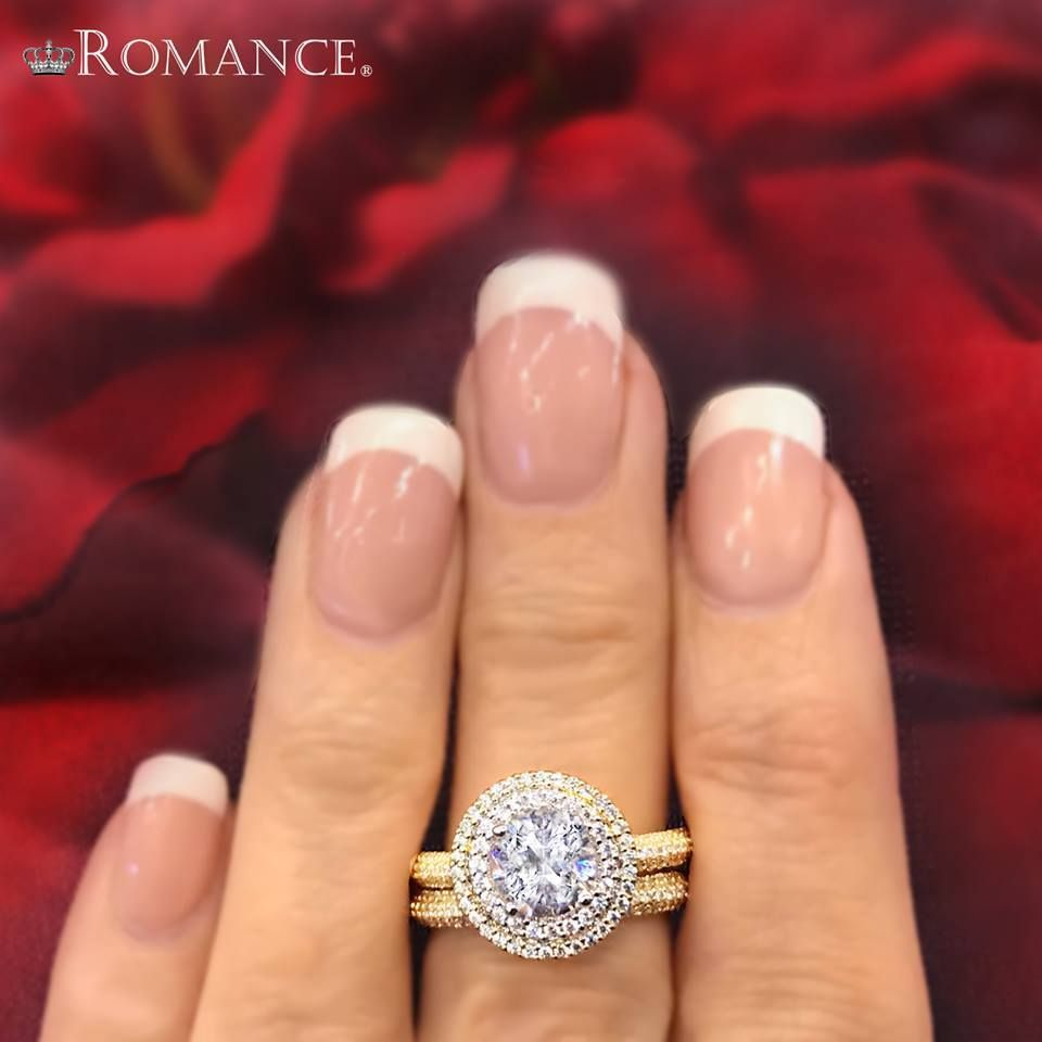 Double the halo, double the diamond sparkle. Check out this yellow gold beauty. 117570-100.  #lovemyromance #engagementrings #shesaidyes #diamonds #weddingrings