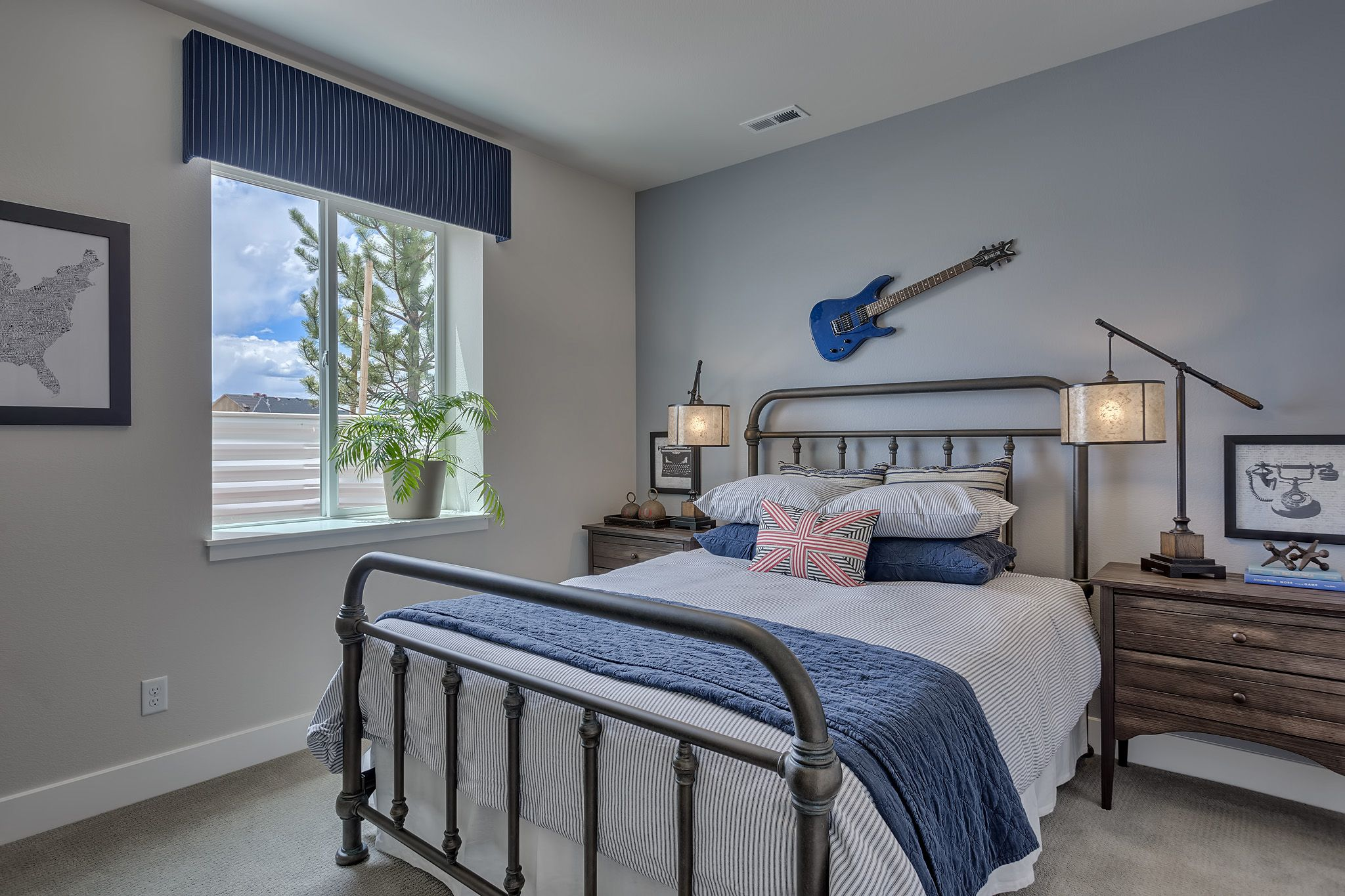 lower level boys' bedroom with blue accent wall fresco