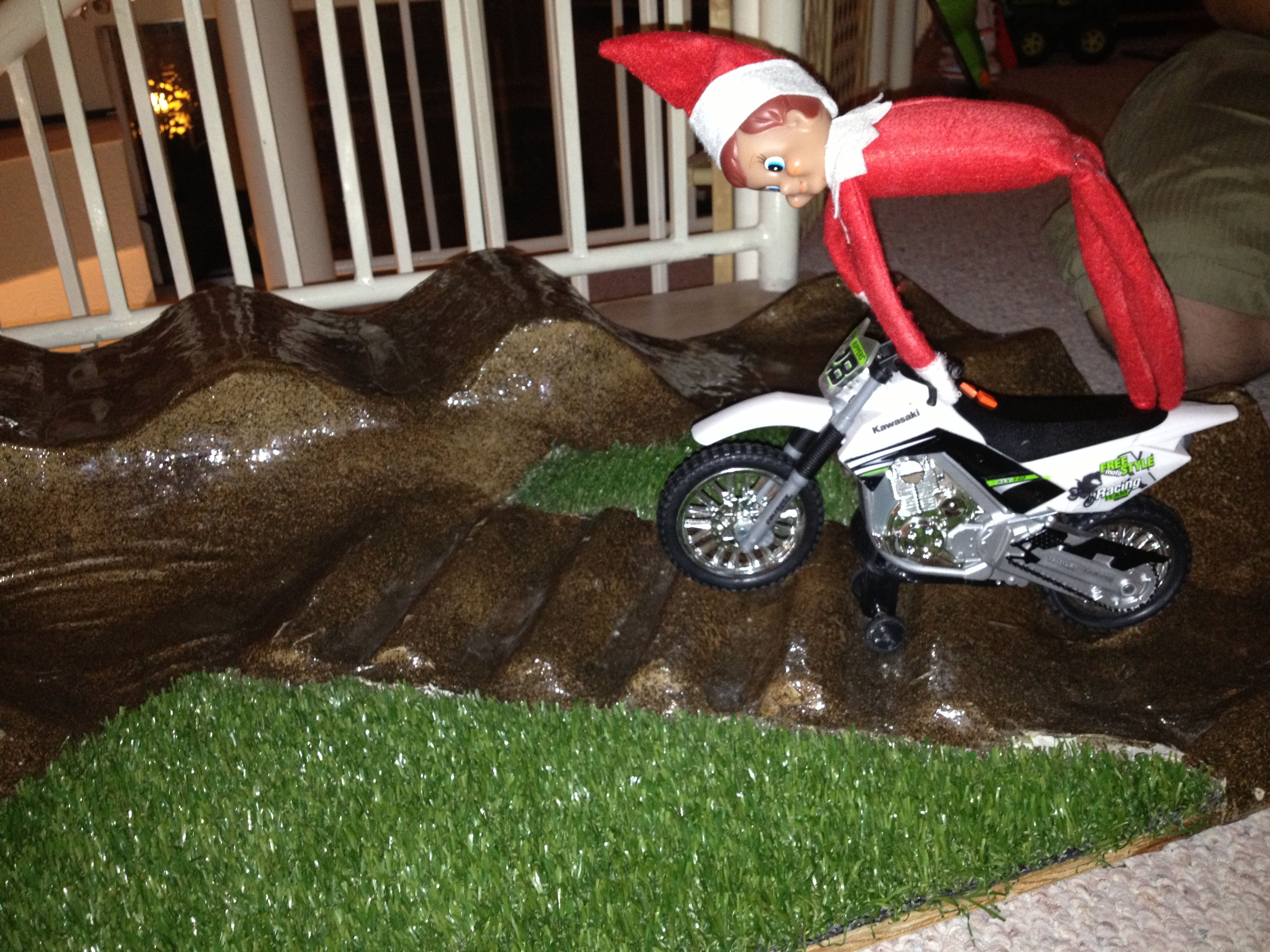 Elf on the shelf doing tricks on dirt bike track
