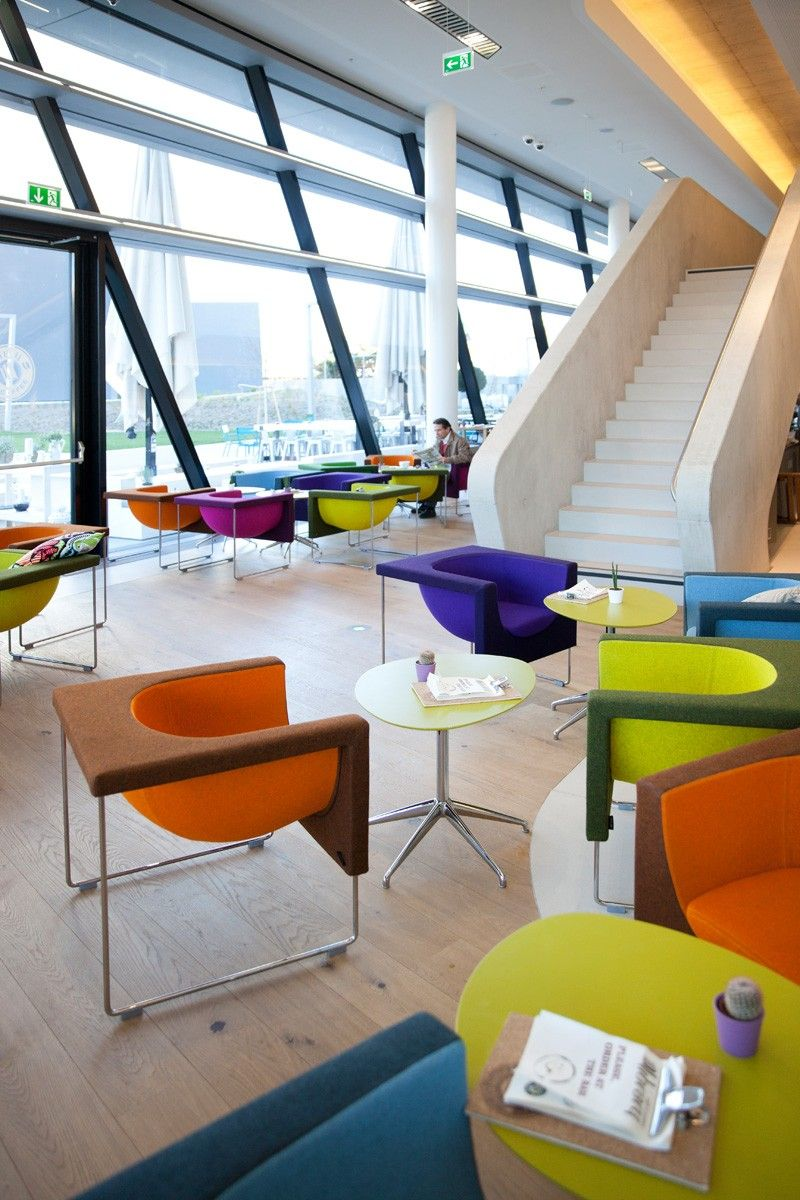Modern furniture colorful felt and chrome chairs stua adds some color to the vienna university of economics and business