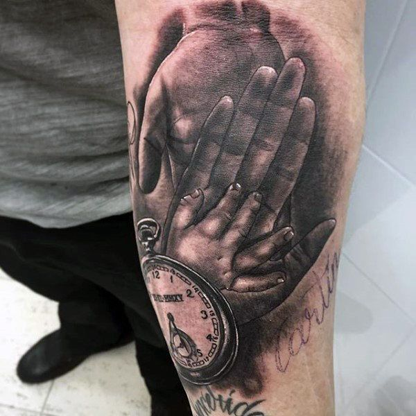 Taschenuhr tattoo hand  Baby Hands Over Dads With Clock Family Tattoo Mens Forearms ...