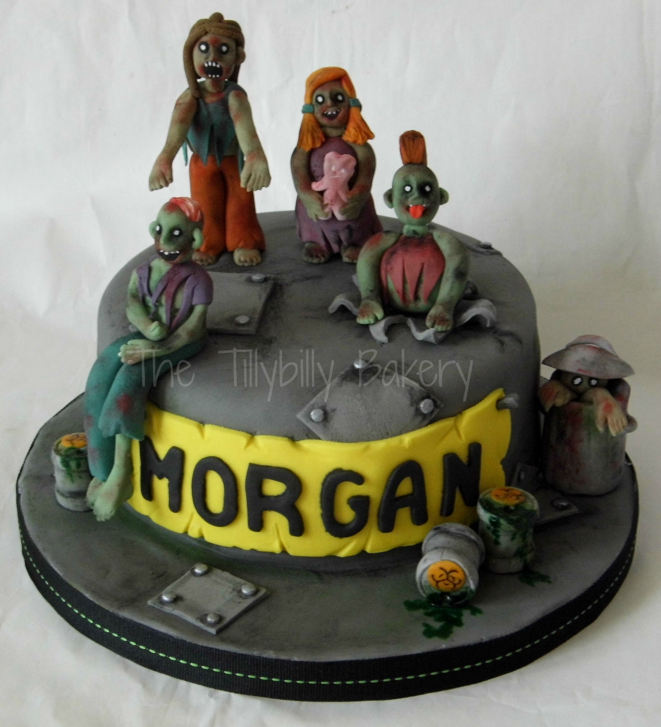 Zombie cake for a horror mad teen Fondant figures and metal plate