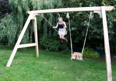 Wooden Oak Swing Frame With Children S Swing Being Used By An