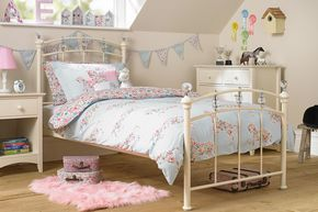 A delightfully girly bed to suit all ages, this single bedstead in a classic ivory white finish is designed with gorgeous, eye catching crystal-effect finials and chrome detailing. A sprung slatted base ensures a dreamy night's sleep.