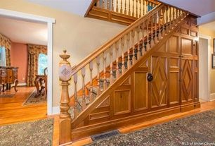 Traditional Staircase with High ceiling, Carpet, Hardwood floors