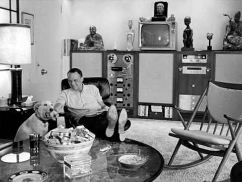 Frank Sinatra throws his feet up and relaxes in his Eames lounge and ottoman. Photo: Unknown
