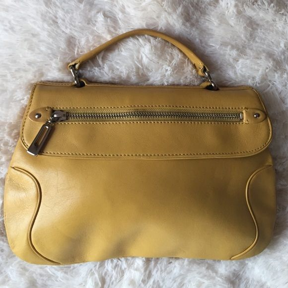 ColeHaan Mustard HandBag Please look at my whole closet for NEW/Barely Used clothes, shoes, make-up and ect! NO TRADES ☺️ Please e-mail if you are interested JenniferLNavarrete@yahoo.com Cole Haan Bags