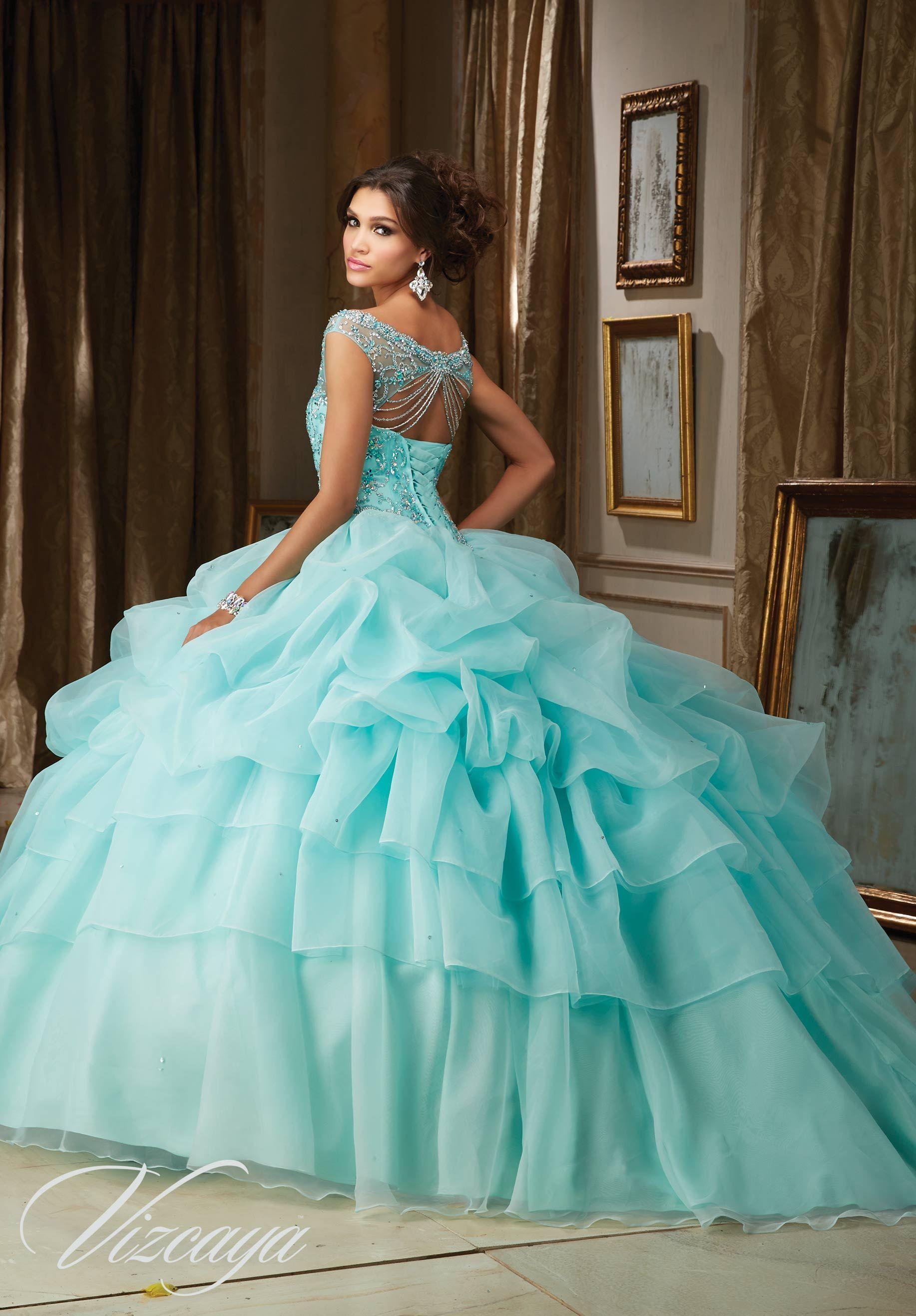 Jeweled beading on a billowy organza quinceañera dress aqua blue