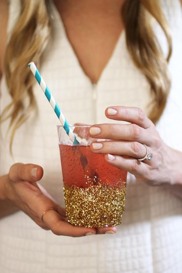 DIY Glitter-Dipped Cups: These quick and easy DIY glitter-dipped cups will give your disposable dinnerware some extra sparkle. Pretty and perfect for any occasion, these cups are as good as gold! What you'll need: Disposable clear plastic cups, Gold craft glitter, Super 77 spray adhesive, Latex gloves